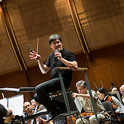 June 3, 2014 - New York, NY : New York Philharmonic Music Director Alan Gilbert, center, interacts with composer Wang Lu (not visible) as the orchestra rehearses one of her pieces at Avery Fisher Hall on Tuesday. Three works by little-known composers, such as Lu, will be selected for inclusion in the New York Philharmonic's Biennial. CREDIT: Karsten Moran for The New York Times
