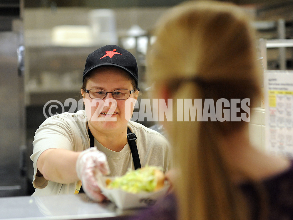 WARRINGTON, PA - APRIL 28:  Tracey Bulvin (L), of Feasterville, Pennsylvania serves lunch to Rachel Fischer, 18 of Warrington, Pennsylvania during lunch period at Central Bucks South April 28 2014 in Warrington, Pennsylvania. Aramark, Central Bucks' food service provider, has asked the district to consider opting out of the National School Lunch Program on the high school level. The district would lose some federal funding if it does so, but it stands to lose much more in revenue because of changes coming next year regarding snacks and a la carte items sold to students.  (Photo by William Thomas Cain/Cain Images)
