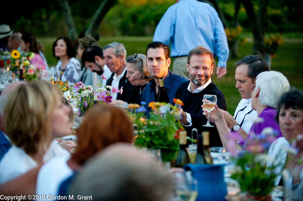 "Amagansett, NY - 8/28/10 - Guests enjoy the food and wine during a benefit at Quail Hill Farm called ""At the Common Table Dinner""  in Amagansett, NY August 28, 2010. CREDIT: Gordon M. Grant for The Wall Street Journal.nyqualihill"