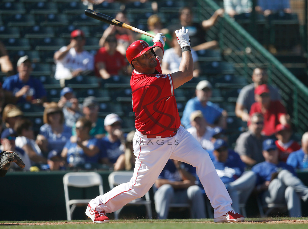 Mar 9, 2016; Tempe, AZ, USA; Los Angeles Angels first baseman Albert Pujols (5) hits in the fourth inning during a spring training game against the Los Angeles Dodgers at Tempe Diablo Stadium. Mandatory Credit: Rick Scuteri-USA TODAY Sports