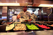 Chefs prepare food onboard the cruise ship Oasis of the Seas. The ship, currently the largest in the world, is owned by Royal Carribean Cruise Line.