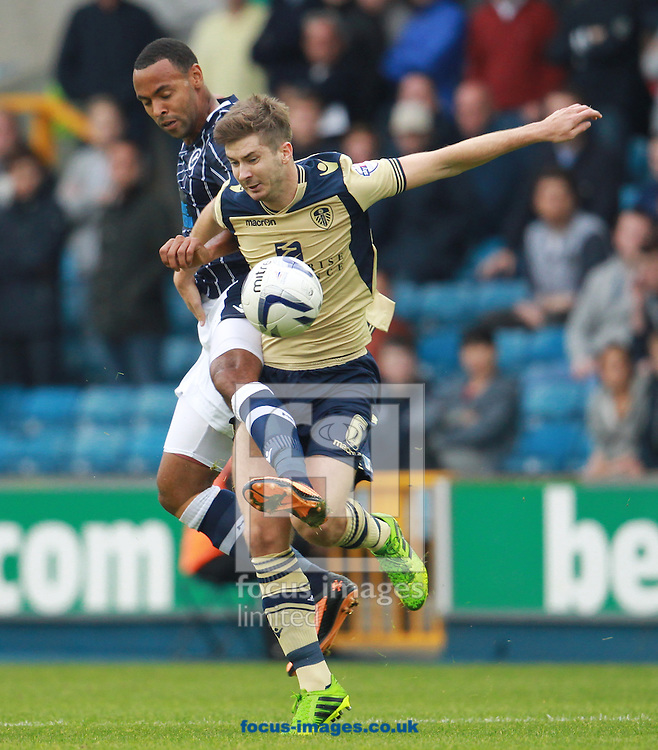 Picture by John Rainford/Focus Images Ltd +44 7506 538356<br /> 28/09/2013<br /> Liam Trotter of Millwall and Luke Murphy of Leeds United during the Sky Bet Championship match at The Den, London.