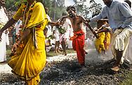 In a trance a fire-walker crosses the hot coals in Tamil Nadu, India.