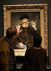 Two visitors admire The Smoker, at a preview of the new Edouard Manet portraiture exhibition at the Royal Academy of Arts in London, Tuesday, 22nd January 2013.Photo by: Stephen Lock / i-Images