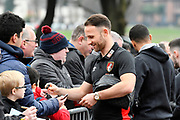 Marc Pugh (7) of AFC Bournemouth signing autographs for fans on arrival at the Vitality Stadium before the Premier League match between Bournemouth and Arsenal at the Vitality Stadium, Bournemouth, England on 14 January 2018. Photo by Graham Hunt.