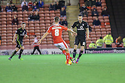 Barnsley midfielder Conor Hourihane  and York City midfielder, on loan from Oxford United, Michael Collins  during the Johnstone's Paint Trophy match between Barnsley and York City at Oakwell, Barnsley, England on 10 November 2015. Photo by Simon Davies.