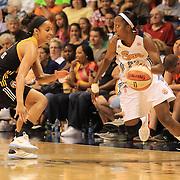 Allison Hightower, Connecticut Sun, drives past Skylar Diggins, Tulsa Shock, during the Connecticut Sun V Tulsa Shock WNBA regular game at Mohegan Sun Arena, Uncasville, Connecticut, USA. 2nd July 2013. Photo Tim Clayton