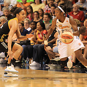Allison Hightower, Connecticut Sun, drives past Skylar Diggins, Tulsa Shock, during the Connecticut Sun V Tulsa Shock WNBA regular game at Mohegan Sun Arena, Uncasville, Connecticut, USA. 2nd July 2013. Photo Tim Clayton