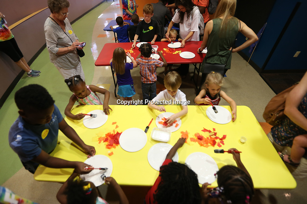Children work on a craft project during Fun and Fit Friday at HealthWorks in Tupelo. The camp is for children and their adult relatives where they have story time, crafts and an obstacle course in the Zoom Room.