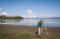 ANGUILLARA SABAZIA (LAKE BRACCIANO), ITALY - 26 JULY 2017: An ACEA technician (the Roman city water utility) measured the water level by Lake Bracciano, whose level has dropped more than 1,50 meters recently, in Anguillara Sabazia (Lake Bracciano), Italy, on July 26th 2017.<br /> <br /> Lake Bracciano provides eight percent of Rome's water and has sunk about 1.5 meters<br /> <br /> A severe drought and sweltering temperatures have led Rome city officials to consider a potential rationing of drinking water for eight hours a day for a million and a half Rome residents. The water crisis has become yet another sign of man being at the mercy of an increasingly extreme climate, but also of once mighty Rome's political impotence, managerial ineptitude and overall decline.Lake Bracciano provides eight percent of Rome's water and has sunk about 1.5 meters<br /> <br /> A severe drought and sweltering temperatures have led Rome city officials to consider a potential rationing of drinking water for eight hours a day for a million and a half Rome residents. The water crisis has become yet another sign of man being at the mercy of an increasingly extreme climate, but also of once mighty Rome's political impotence, managerial ineptitude and overall decline.