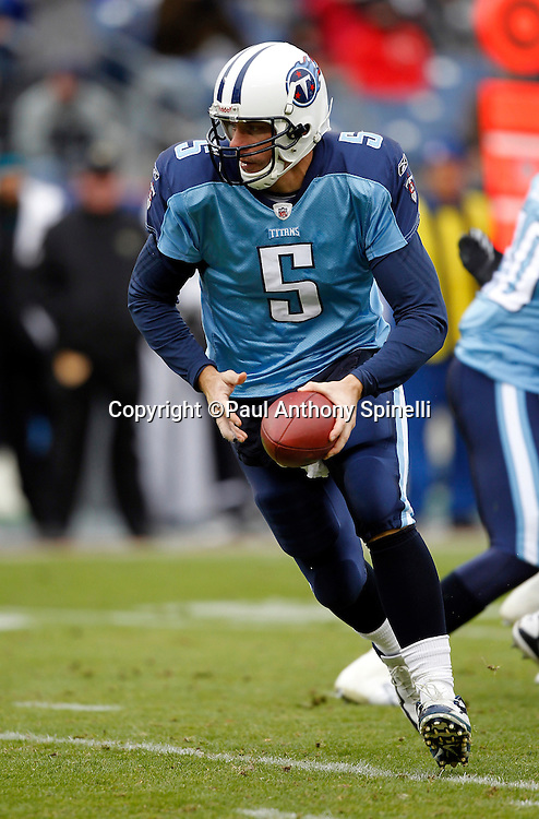 Tennessee Titans quarterback Kerry Collins (5) hands off the ball on a running play during the NFL week 13 football game against the Jacksonville Jaguars on Sunday, December 5, 2010 in Nashville, Tennessee. The Jaguars won the game 17-6. (©Paul Anthony Spinelli)