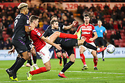 Charlton Athletic defender Adam Matthews (2) gets a toe to the ball under pressure from Middlesbrough defender Dael Fry (6) during the EFL Sky Bet Championship match between Middlesbrough and Charlton Athletic at the Riverside Stadium, Middlesbrough, England on 7 December 2019.