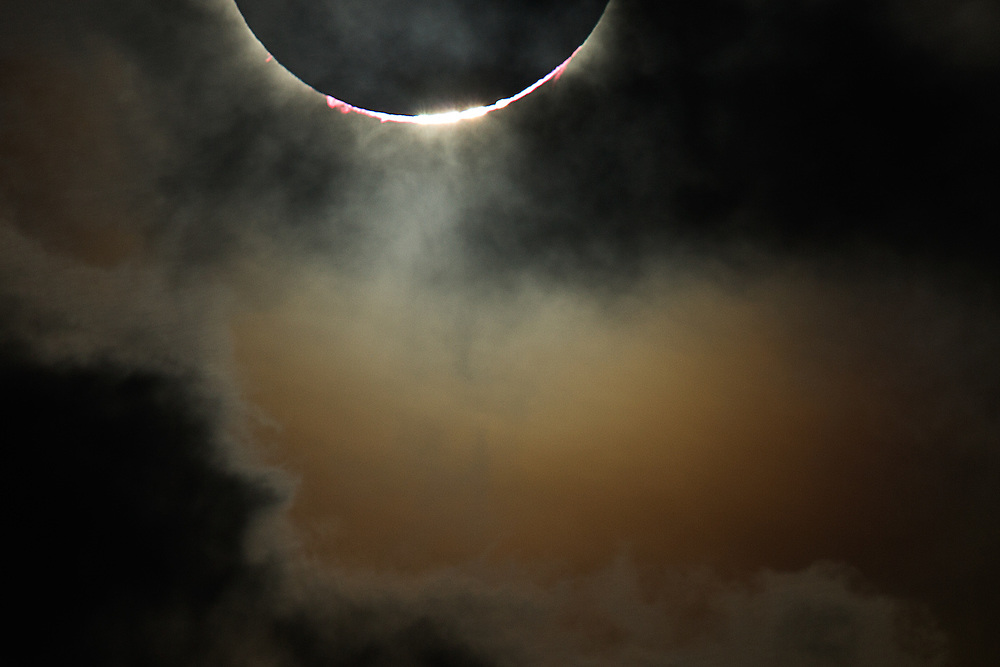 Details of totality and Baily's Beads surrounded by clouds still lit by the sun's light, Australia, 14 November 2012