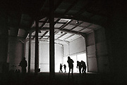 Ravers taking a photo in a warehouse, Free Party, Avonmouth, Bristol, UK, June 2014.