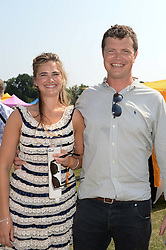 JACK KIDD and CALLIE MOORE at the Veuve Clicquot Gold Cup, Cowdray Park, Midhurst, West Sussex on 21st July 2013.