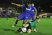 Scunthorpe United midfielder Neil Bishop (12) tackles AFC Wimbledon striker Lyle Taylor (33) during the EFL Sky Bet League 1 match between AFC Wimbledon and Scunthorpe United at the Cherry Red Records Stadium, Kingston, England on 16 August 2016. Photo by Stuart Butcher.