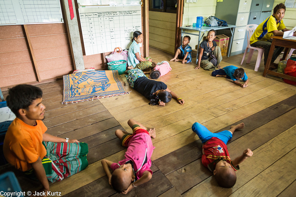 21 MAY 2013 - MAE KU, TAK, THAILAND:  People participating in a test of malaria drugs relax in the observation room at the Mawker Thai SMRU clinic in Mae Ku, Thailand. Health professionals are seeing increasing evidence of malaria resistant to artemisinin coming out of the jungles of Southeast Asia. Artemisinin has been the first choice for battling malaria in Southeast Asia for 20 years. In recent years though,  health care workers in Cambodia and Myanmar (Burma) are seeing signs that the malaria parasite is becoming resistant to artemisinin. Scientists who study malaria are concerned that history could repeat itself because chloroquine, an effective malaria treatment until the 1990s, first lost its effectiveness in Cambodia and Burma before spreading to Africa, which led to a spike in deaths there. Doctors at the Shaklo Malaria Research Unit (SMRU), which studies malaria along the Thai Burma border, are worried that artemisinin resistance is growing at a rapid pace. Dr. Aung Pyae Phyo, a Burmese physician at a SMRU clinic just a few meters from the Burmese border, said that in 2009, 90 percent of patients were cured with artemisinin, but in 2010, it dropped to about 70 percent and is now between 55 and 60 percent. He said the concern is that as it becomes more difficult to clear the parasite from a patient, progress that has been made in combating malaria will be lost and the disease could make a comeback in Southeast Asia.  PHOTO BY JACK KURTZ