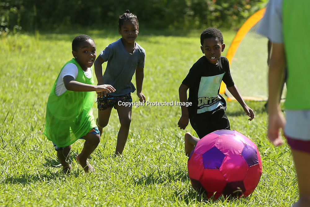 Cartavious Hadley, 8, of Tupelo, drives the soccer ball up field looking to score as he and other children attend soccer camp at Hilldale Apartments Wednesday morning in Tupelo. The camp was led by Hannah Kimbrough, Tupelo Girls Head Soccer Coach, and some of her players.