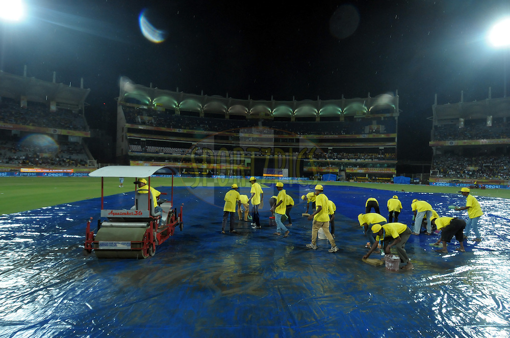 Ground staff clean the ground during rain  match 21 of the Pepsi Indian Premier League Season 2014 between the Chennai Superkings and the Kolkata Knight Riders  held at the JSCA International Cricket Stadium, Ranch, India on the 2nd May  2014<br /> <br /> Photo by Arjun Panwar / IPL / SPORTZPICS<br /> <br /> <br /> <br /> Image use subject to terms and conditions which can be found here:  http://sportzpics.photoshelter.com/gallery/Pepsi-IPL-Image-terms-and-conditions/G00004VW1IVJ.gB0/C0000TScjhBM6ikg