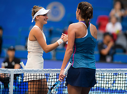 September 23, 2018 - Marketa Vondrousova of the Czech Republic & Julia Goerges of Germany at the net after their first-round match at the 2018 Dongfeng Motor Wuhan Open WTA Premier 5 tennis tournament (Credit Image: © AFP7 via ZUMA Wire)