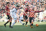 fAdam Le Fondre (Bolton Wanderers) takes a shot with Nicky Law (Bradford City) closing him down during the EFL Sky Bet League 1 match between Bradford City and Bolton Wanderers at the Coral Windows Stadium, Bradford, England on 18 February 2017. Photo by Mark P Doherty.
