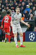 Liverpool midfielder James Milner (7) protests during the Champions League match between Bayern Munich and Liverpool at the Allianz Arena, Munich, Germany, on 13 March 2019.