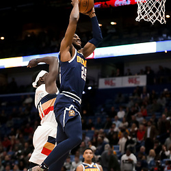 Jan 30, 2019; New Orleans, LA, USA; Denver Nuggets guard Malik Beasley (25) dunks New Orleans Pelicans guard Jrue Holiday (11) during the first quarter at the Smoothie King Center. Mandatory Credit: Derick E. Hingle-USA TODAY Sports
