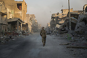 An Iraqi soldier walks along a street in Mosul's devastated Old City as Iraq's Prime Minister Haider al-Abadi declares victory against Islamic State forces in Mosul on July 9, 2017.<br />