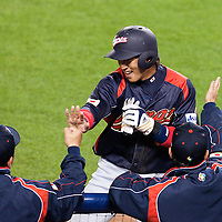 23 March 2009: #6 Hiroyuki Nakajima of Japan celebrates with teammates after scoring during the 2009 World Baseball Classic final game at Dodger Stadium in Los Angeles, California, USA. Japan defeated Korea 5-3