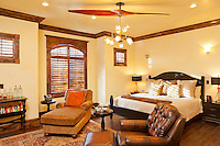 The master bedroom was remodeled with venetian plaster walls, crown molding and a new hardwood floor. Check out the airplane propeller fan, very cool.