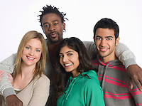 Portrait of young people embracing studio shot