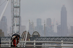 © Licensed to London News Pictures. 26/11/2019. London, UK. Commuters and tourist walk over Waterloo Bridge in the rain as a mist of rain covers the Capital while Storm Sebastien continues to batter the South of England as the Met Office issue weather warnings for the South West.