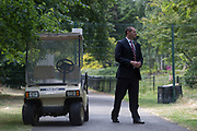 An American Secret Service agent guards a temporary perimeter fence encircling Winfield House, the official residence of the US Ambassador during the visit to the UK of US President, Donald Trump, on 12th July 2018, in Regent's Park, London, England.