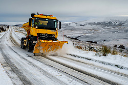 Winter comes to the Scottish Highlands - A snow plow clears the A939 Old Military Road near Tomintoul.  At 1400 feet above sea level it is one of the highest roads in Scotland.<br /> <br /> (c) Andrew Wilson | Edinburgh Elite media