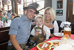05.10.2014, Theresienwiese, München, GER, 1. FBL, FC Bayern Muenchen am Oktoberfest, im Bild Philipp Lahm (L) of FC Bayern Muenchen, his wife Claudia and son Julian attend the Oktoberfest 2014 beer festival at Kaefers Wiesenschaenke at Theresienwiese on 2014/10/05. EXPA Pictures © 2014, PhotoCredit: EXPA/ Eibner-Pressefoto/ Pool<br /> <br /> *****ATTENTION - OUT of GER*****