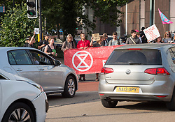 © Licensed to London News Pictures. 17/07/2019; Bristol, UK. Extinction Rebellion Summer Uprising 2019. Extinction Rebellion block a major road junction at morning rush hour on Newfoundland Road coming into Bristol city centre causing traffic delays up the M32 to the M4 motorway. Campaigners locked themselves onto a pink bath tub, and held 7 minute roadblocks on other parts of the junction complex. Extinction Rebellion are holding a five-day 'occupation' of Bristol, by occupying Bristol Bridge in the city centre and traffic has to be diverted and carrying out other events. As part of a country-wide rebellion called Summer Uprising, followers will be holding protests in five cities across the UK including Bristol on the theme of water and rising sea levels, which is the group's focus for the South West. The campaign wants the Government to change its recently-set target for zero carbon emissions from 2050 to 2025. Photo credit: Simon Chapman/LNP.