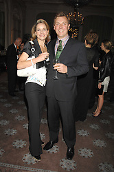 DARCEY BUSSELL and her husband ANGUS FORBES at a dinner to celebrate the launch of the Dom Ruinart 1998 vinatage champage at Claridge's, Brook Street, London W1 on 23rd April 2008.<br />