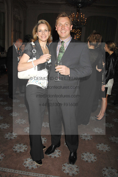 DARCEY BUSSELL and her husband ANGUS FORBES at a dinner to celebrate the launch of the Dom Ruinart 1998 vinatage champage at Claridge's, Brook Street, London W1 on 23rd April 2008.<br /><br />NON EXCLUSIVE - WORLD RIGHTS