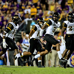 Oct 15, 2016; Baton Rouge, LA, USA;  Southern Miss Golden Eagles defensive back Cornell Armstrong (3) celebrates with teammates defensive back Devonta Foster (15) and defensive back Picasso Nelson Jr. (13) and linebacker Sherrod Ruff (37) after a defensive stop against the LSU Tigers during the first half of a game at Tiger Stadium. Mandatory Credit: Derick E. Hingle-USA TODAY Sports