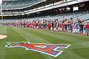 ANAHEIM, CA - MAY 22:  Young and older baseball fans walk around the edge of the field before the game between the Atlanta Braves and the Los Angeles Angels of Anaheim on Sunday, May 22, 2011 at Angel Stadium in Anaheim, California. The Angels won the game 4-1. (Photo by Paul Spinelli/MLB Photos via Getty Images)