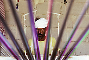 """As Shir, a craftman working the cloth for  hand made """"mavas"""", the traditional men's skirts."""