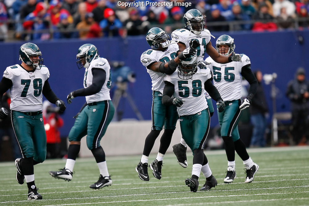 7 Dec 2008: Philadelphia Eagles defensive end Trent Cole #58 gets congratulated from teamates after a play during the game against the New York Giants on December 7th, 2008. The Eagles won 20-14 at Giants Stadium in East Rutherford, New Jersey.