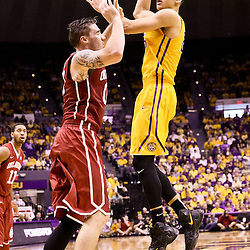 Jan 30, 2016; Baton Rouge, LA, USA; LSU Tigers forward Ben Simmons (25) shoots over Oklahoma Sooners forward Ryan Spangler (00) during the first half of a game at the Pete Maravich Assembly Center. Mandatory Credit: Derick E. Hingle-USA TODAY Sports