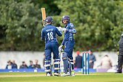 Scotland's Donald MacLeod (#10) is congratulated by Craig Wallace (#18) after scoring 100 runs during the One Day International match between Scotland and Afghanistan at The Grange Cricket Club, Edinburgh, Scotland on 10 May 2019.