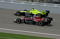 Buddy Rice races Vitor Meira at the Kansas Speedway, Kansas Indy 300, July 3, 2005