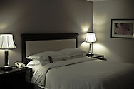 The warmth and homeliness of a hotel room welcomes you to feel like you're in a home away from home.