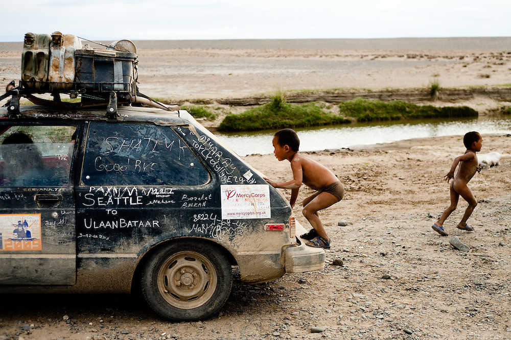 The team Arbitrary Itinerary's 1982 Toyota Starlet broke down for the last time in Govi-Altai Province, Mongolia. They rode to Ulaanbaatar in their car albeit inside the back of a truck.