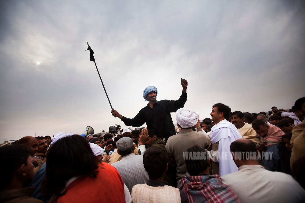 RAWALPINDI, PAKISTAN - FEBRUARY 5: A bull jockey is carried on spectators shoulders after his victory at a bull racing event on February 5, 2011, in Rawalpindi, Pakistan. Bull racing takes place during the winter months throughout Pakistan where many come to watch or gamble on the contenders. (Photo by Warrick Page)
