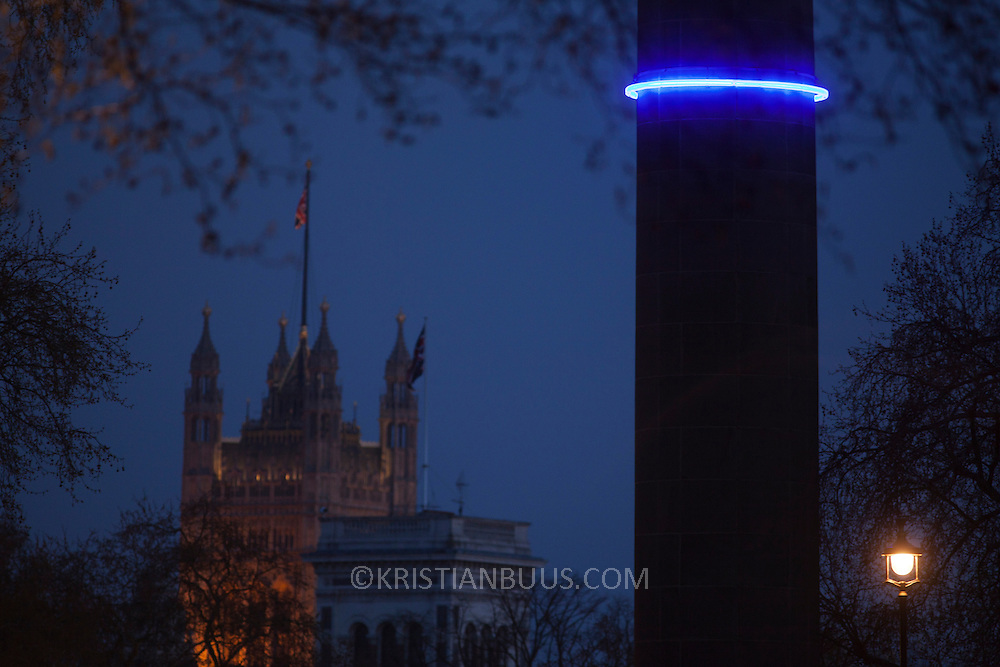 Plunge project by Arts Admin and artist Michael Pinsky. The monument Duke of York has been fitted with a ring of blue light at 28m above sea levels to indicate where the sea levels will be in 1000 years time if we, the human race, continue our CO2 emmissions at current rate. An estimated hight of raised seal levels will be 28m, based on current available science. 3 monuments in London have been fitted with a ring of light at 28 m above sea levels, one is on the Duke of York Monument, another the monument in Paternoster Square and the third on the monument in Sevel Dials in Covent Garden.