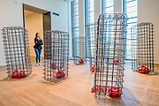 Cellules 2012-13 - Mona Hatoum a new Tate Modern exhibition. It presents around 100 works from the 1980s to the present day, including early performances and video, sculpture, installation, photography and works on paper. Mona Hatoum runs from 4 May to 21 August 2016.<br /> <br /> Highlights include:  Large-scale installations that fill entire rooms, including Impenetrable 2009, a suspended square formed of hundreds of delicate rods of barbed wire which hover above the floor, and Light Sentence 1992, in which walls of wire mesh lockers and a single lightbulb cast constantly moving shadows; Hot Spot 2013, a giant globe that uses red neon to outline the contours of the continents; a kinetic sculpture in which a rotating motor-driven arm draws circular lines across a large sandpit; and Homebound 2000, an installation of kitchen utensils and furniture which buzzes with electricity